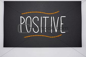 Positive written on big blackboard