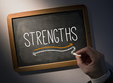 Hand writing Strengths on chalkboard