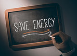 Hand writing Save energy on chalkboard