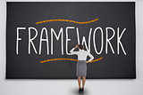 Businesswoman considering the word framework