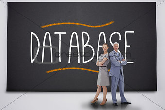 Business people standing against the word database