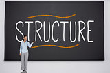 Businesswoman presenting the word structure