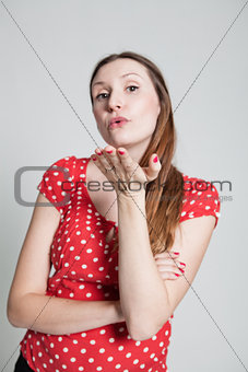 Attractive woman blowing kiss