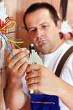 Electrician peeling wire endings