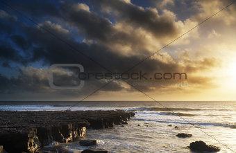 Beautiful ocean landscape image during stunning sunset