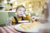 Bored little boy in a restaurant
