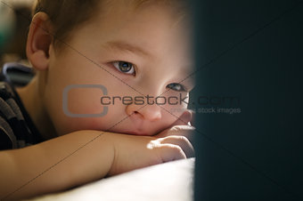 Boy watching cartoons on touchpad