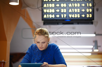Woman with touchpad in the waiting room