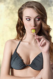 pretty woman eating lollipop