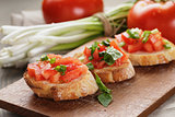 simple italian appetizing bruschetta with tomato