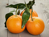 ripe oranges on wooden table