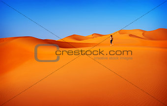 Woman traveler in desert