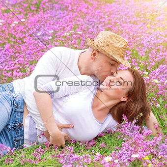 Young family kissing in the garden