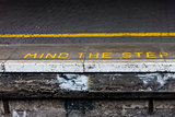 Mind the step warning on railway platform