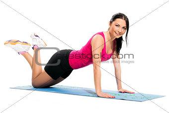 Cute brunette on the exercise mat