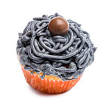 Cupcake with gray icing against white background in front of white background
