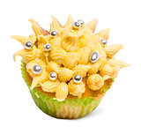 Cupcake with yellow icing and decoration against white background in front of white background