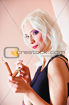 Closeup portrait of cute blonde girl with candies in hands