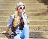Young hipster sitting on stairs outdoors