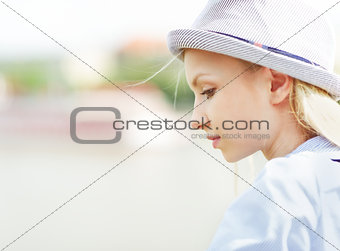 Portrait of thoughtful young hipster outdoors