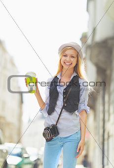 Portrait of happy young hipster in the city