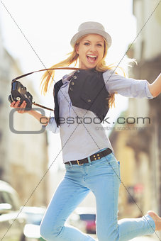 Happy young hipster having fun in the city