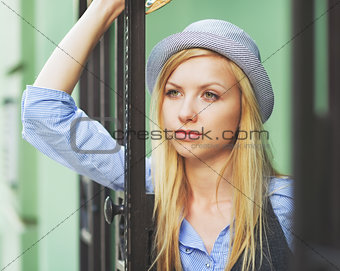 Portrait of thoughtful young hipster in the city