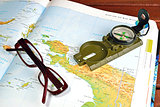 Compass,  maps and glasses