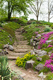 Stone stairs in the park surrounded by flowers