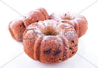 Three powdered yummy cakes with raisins