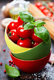 Cherry tomatoes in a bowl with basil