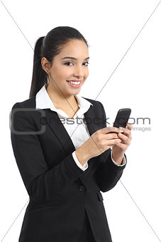 Arab business woman using a smart phone and looking at camera