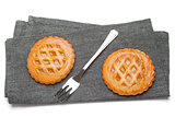 Two tarts on grey napkin