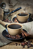 Two cups of coffee with spices