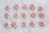 Pink meringues on baking paper
