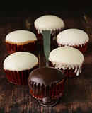 sweet cupcakes with chocolate icing white and black