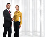 Business woman handshaking with a man