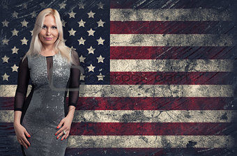 beautiful blonde woman over Grunge USA Flag background