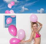 happy woman with bikini and balloons