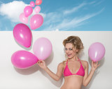 bikini woman with pink balloons