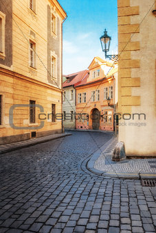 Old city without people . Prague. textured old paper background