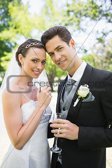 Beautiful bride and groom holding champagne flutes