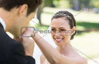 Groom kissing on hand of bride