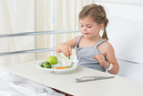 Girl having healthy food in hospital