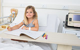 Portrait of girl coloring book in hospital
