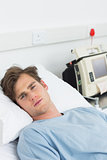 Sick man lying in hospital bed