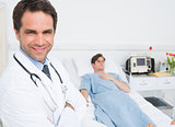 Confident male doctor in hospital ward
