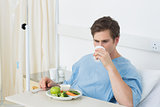 Male patient having meal in hospital
