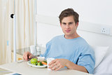 Patient having meal on hospital bed