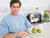 Handsome man having meal in hospital